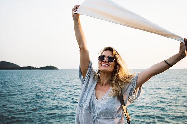 woman celebrating on a beach